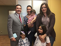The Garcia family poses with Dr. Jimenez